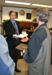 Bill McAllister (left) accepts the petition demanding the removal of the Attorney General from Alaskans for Truth.
